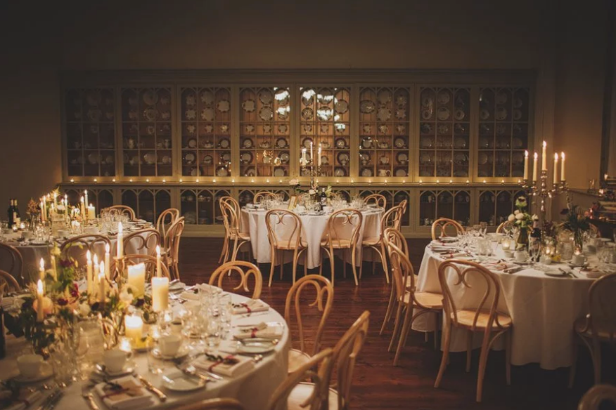 The Ballroom lit with candles for a Winter Wedding