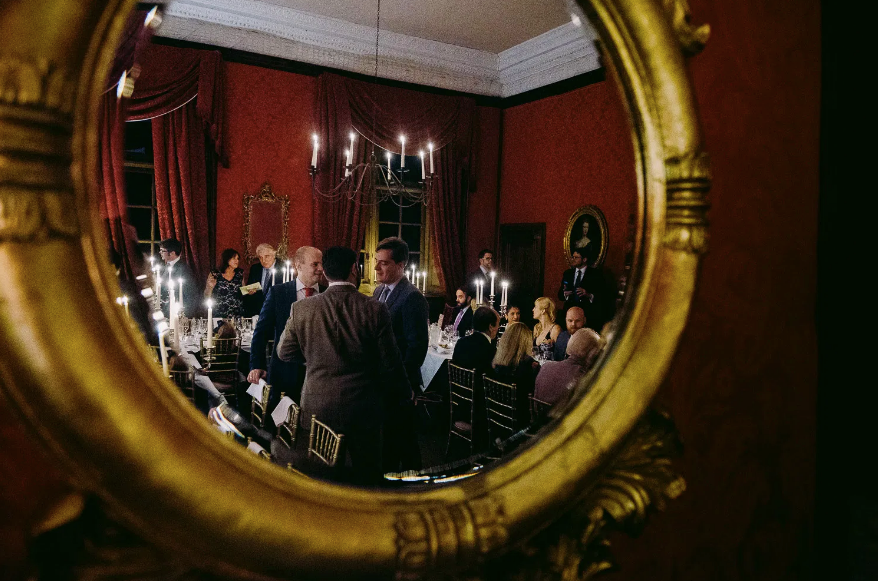 The State Dining Room is lined with silk and lit entirely by candles, with a candle chandelier