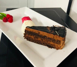 Chocolate Gateau with Raspberry or Lemon Sorbet served with fresh Raspberries and Mint