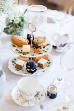 Homemade Cakes, Eclairs and Scones served on Vintage China
