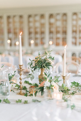 Eclectic Centrepiece Designs: Consider taper candles in candlesticks for a romantic & whimsical feel