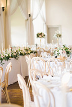 Top Table embellished with fresh flowers, foliage & candles
