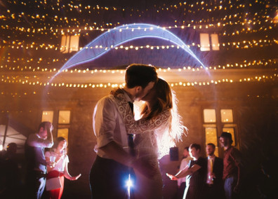 Couple shot in the courtyard, underneath the fairylight canopy