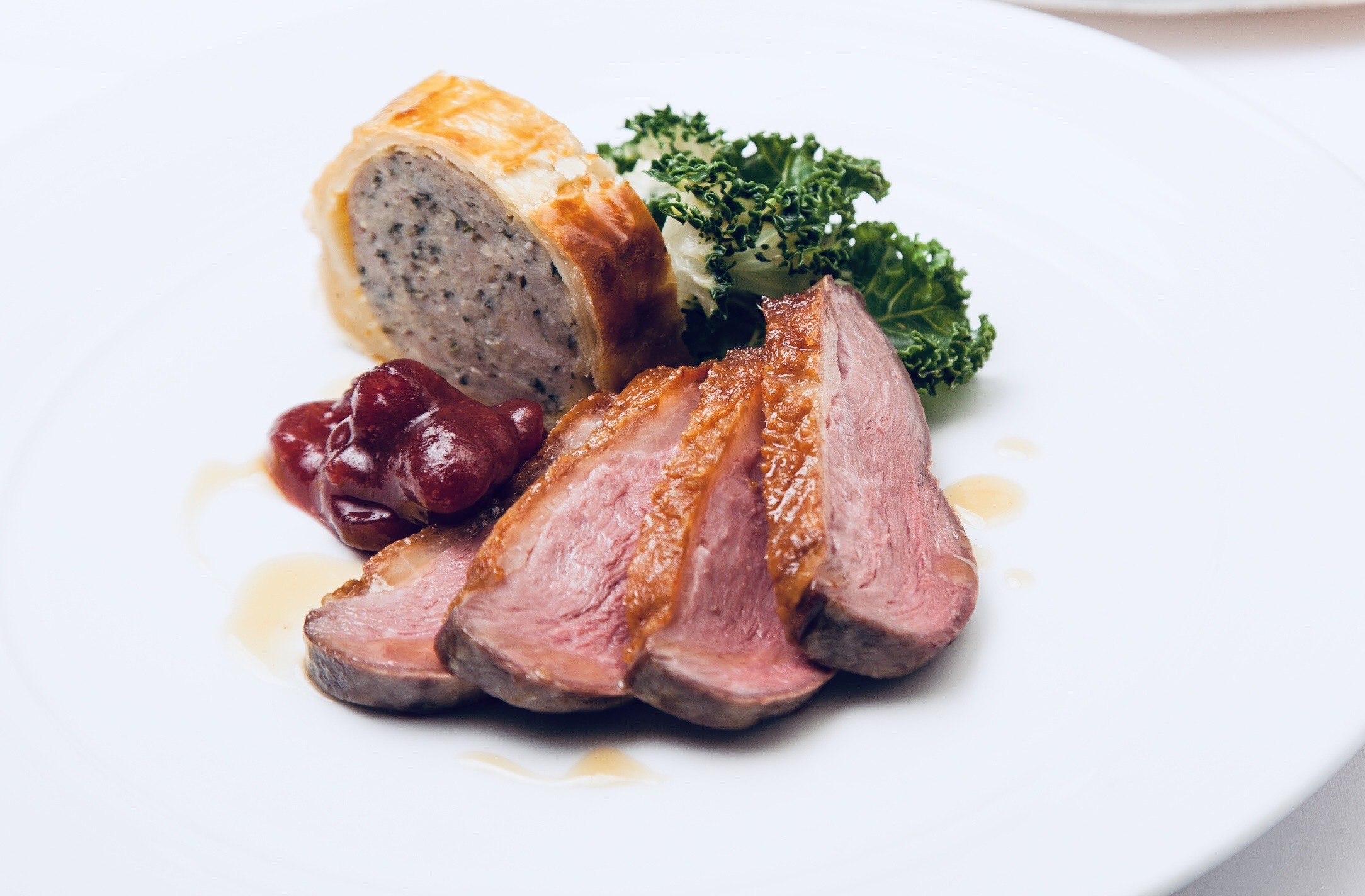 Deconstructed Beef Wellington with fillet Beef and Cranberry Reduction