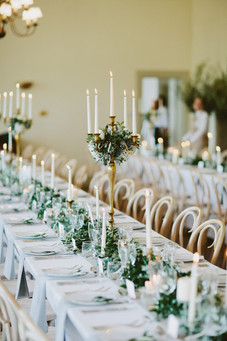 Line your wedding breakfast tables with simple candles and fresh garlands for a fuss-free, organic feel.