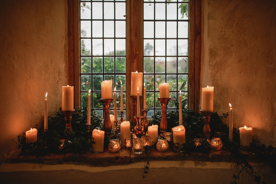 Winter wedding lit by candles
