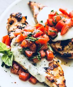 Chicken with a Stilton Sauce and Tomato Garnish