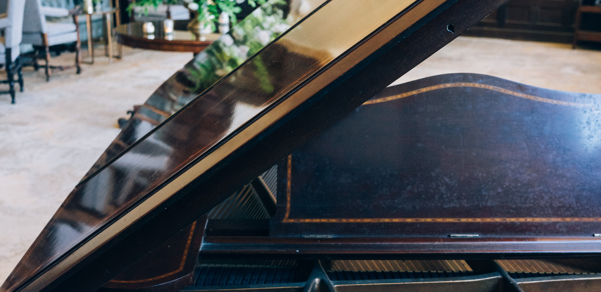 There is a baby grand piano available for use during the drinks reception in the Great Hall