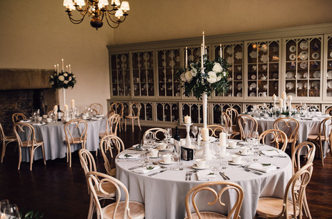 Lush greenery with soft cream and blush florals is rustic and romantic, a dream setting for an elegant wedding.