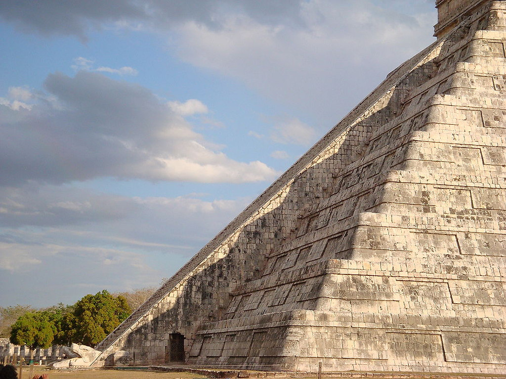 The Kukulkan Pyramid in Chichen Itza was constructed so meticulously that, on the equinox, the 91 stairs and nine tiered platforms illuminate to create an effect forming the body of the feathered serpent god descending from the heavens to the ornately carved head at the base.