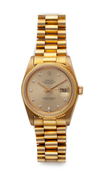 A GENTLEMAN'S GOLD DATEJUST WRISTWATCH BY ROLEX