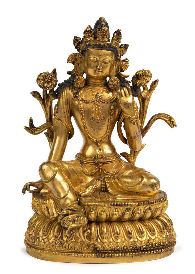 A gilt-bronze figure of Green Tara