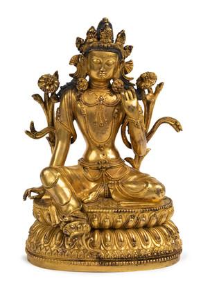 A gilt-bronze figure of Green Tara