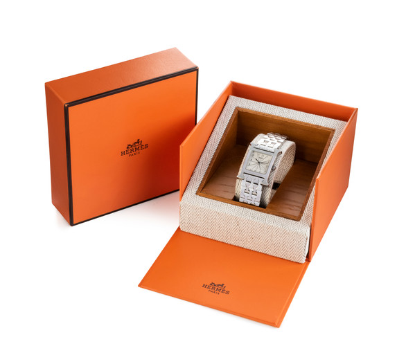 Lot 78: A LADY'S 'H HOUR' WRISTWATCH BY HERMES