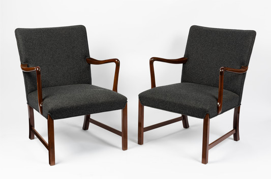 A pair of cashmere upholstered teak elbow chairs by Ole Wansecher, mid 20th century