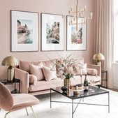 a-refined-living-room-with-blush-walls-blush-furniture-a-chic-gallery-wall-and-touches-of-