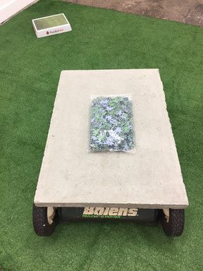 Taking the Lawn into your own hands 2019, DomestiCITY @ c3 Contemporary Artspace, Abottsford.  Cement, Lawnmower parts, synthetic grass, cardboard..  Dimensions variable
