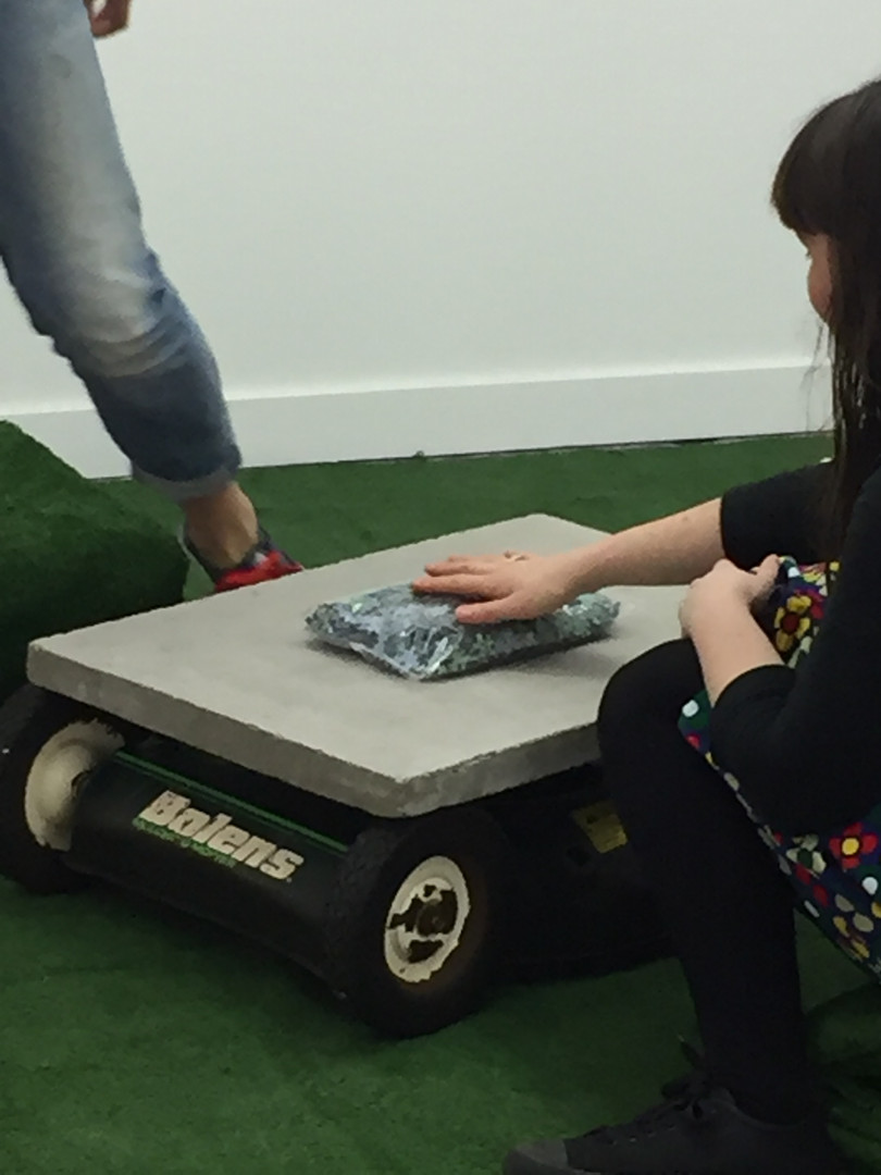 Taking the Lawn into your own hands 2019, DomestiCITY @ c3 Contemporary Artspace, Abottsford.  Cement, Lawnmower parts, synthetic grass, cardboard.  Dimensions variable