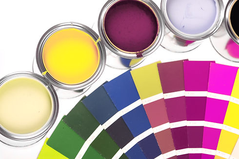 Tan, Yellow, Burgandy, and Lavendar Paint Pots and a Color Wheel with many paint color swatches.