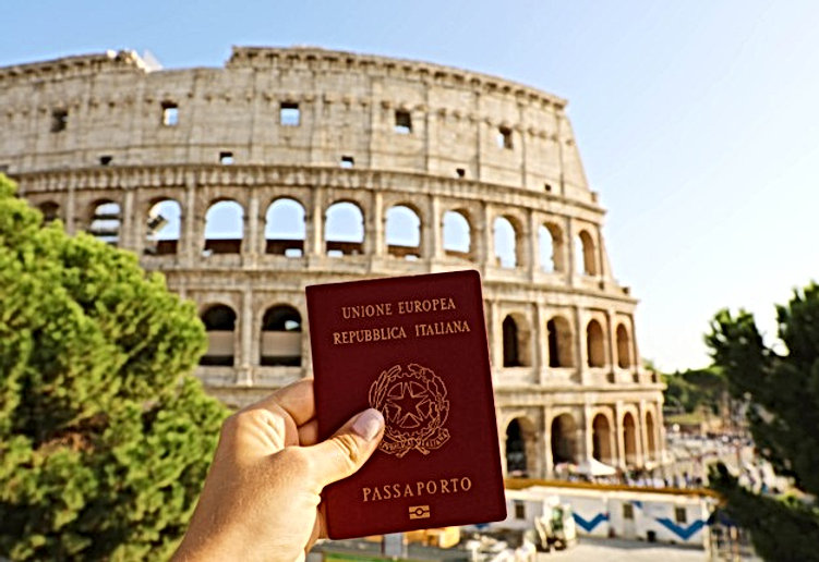 hand-holding-italian-passport-in-front-o