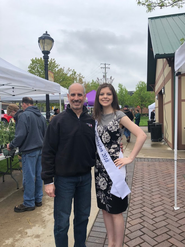 Megan at the Opening of the Summer Market with emcee Paul Gross