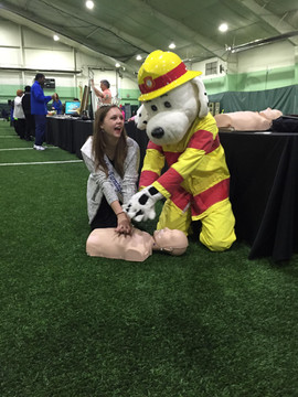 Practicing CPR with our Farmington Hills Firefighter mascot Sparky