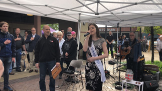 Megan singing the National Anthem at the Opening of the Summer Market