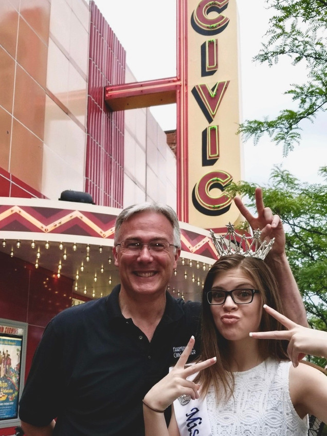 Megan striving a pose with Scott outside of the Civic Theater