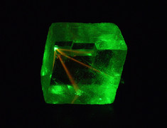 """Gemmy """"Terlingua-type"""" calcite with blue light and green laser fluorescence"""