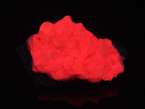 Brightly fluorescent calcite from Sainte-Anne-Des-Monts, Gaspe Peninsula, Quebec, Canada