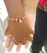 F - Girl with bracelet