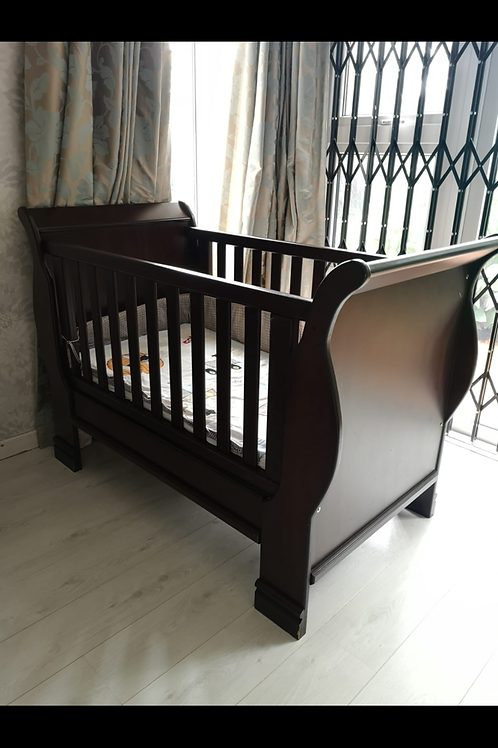 Wooden cot includes mattress and linen