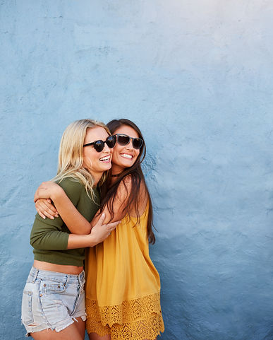 Shot of two best friends embracing over