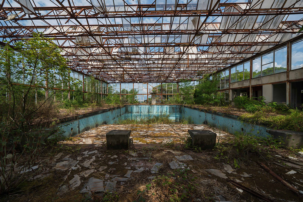 Abandoned swimming pool with natural decay
