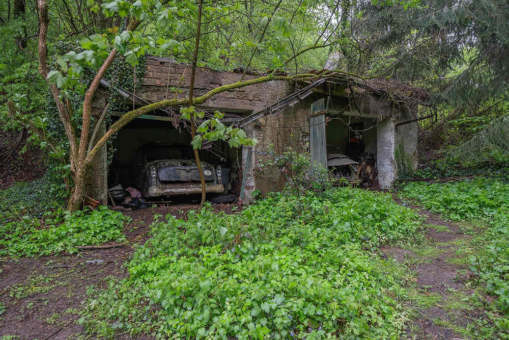 Old cars at abandoned chocolate factory