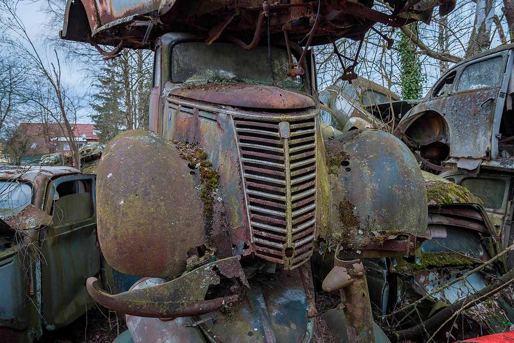Abandoned cars rusting away