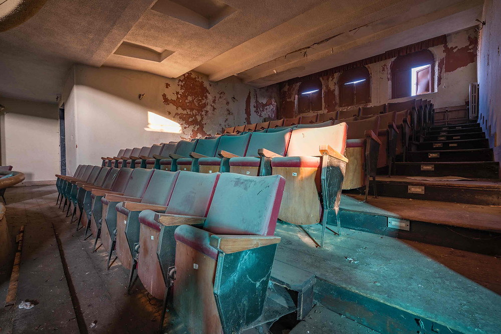 Decaying leather seats in abandoned theater