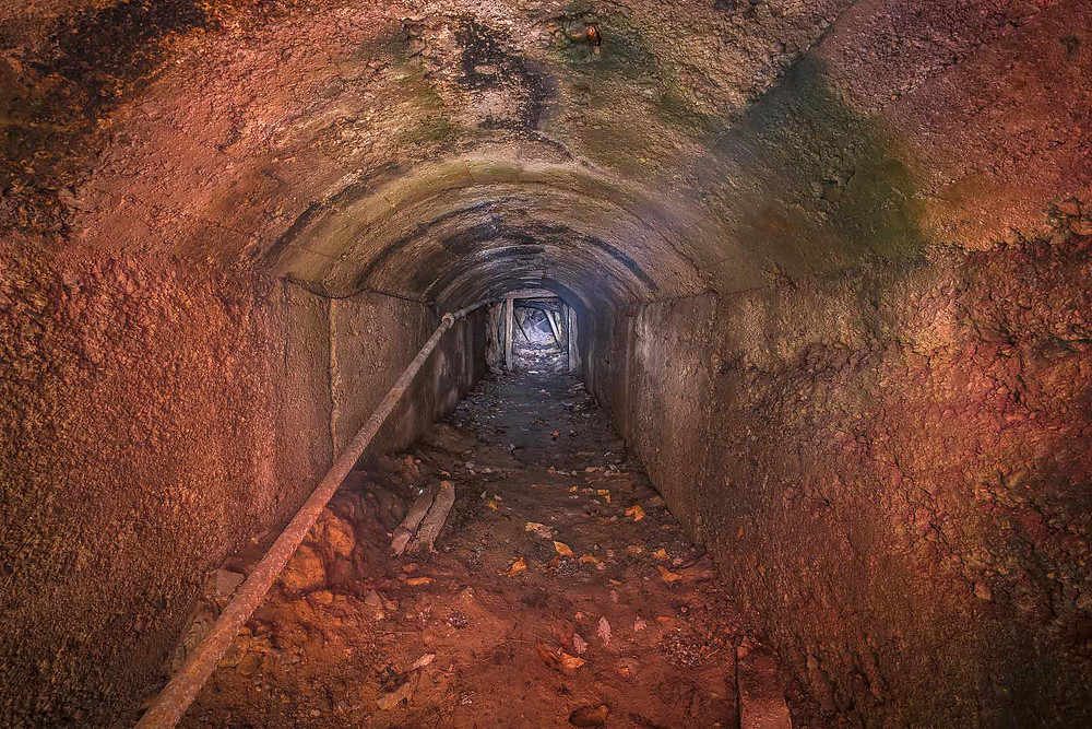 Mine shaft in abandoned mine in italy