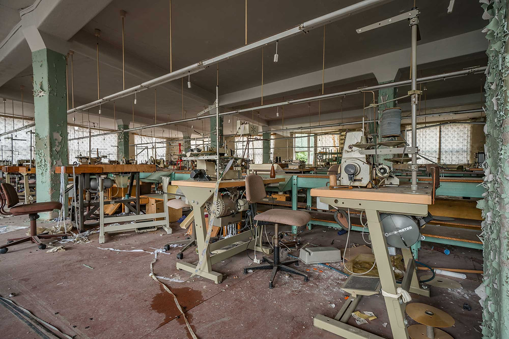 Sewing machines at abandoned clothing factory for 20 years