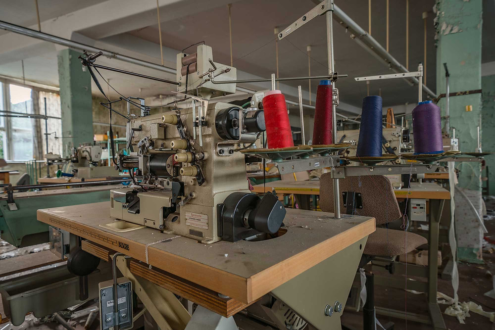 Thread on sewing machine at abandoned factory in Limbach
