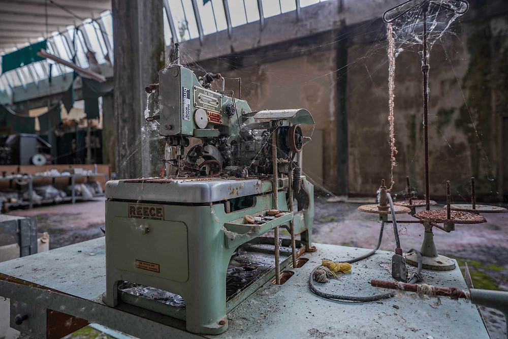 Decaying machine in abandoned factory