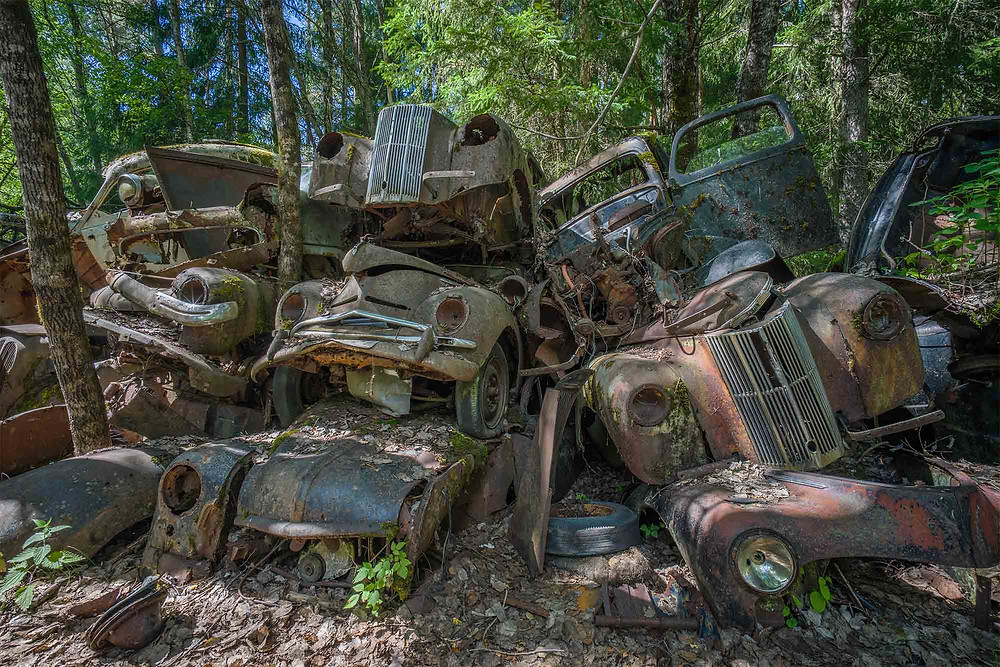 Piles of cars in car cemetery