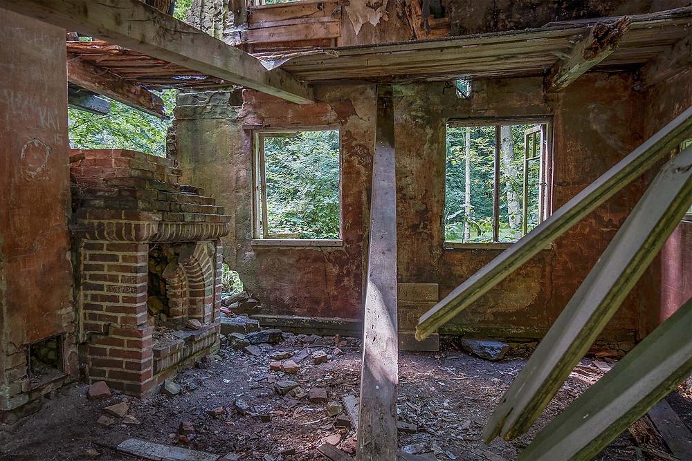 Livingroom of the abandoned forest house in Denmark