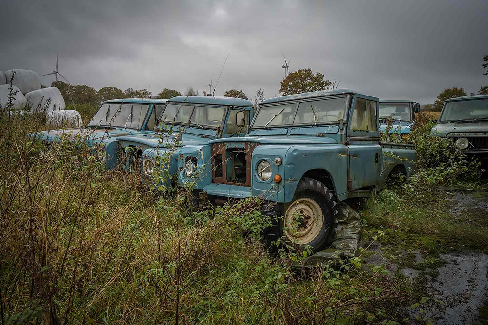 Abandoned Land Rover cars