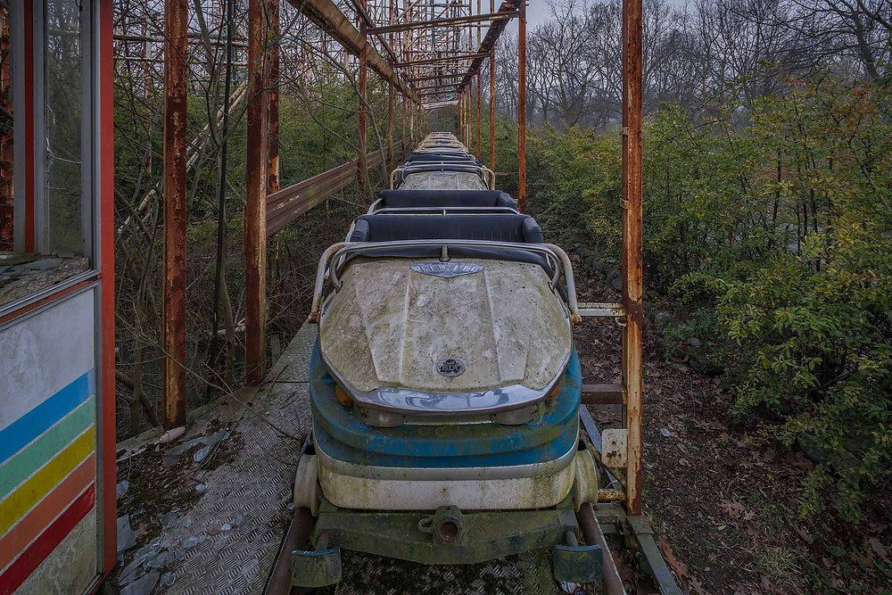 Rollercoaster cart in abandoned theme park