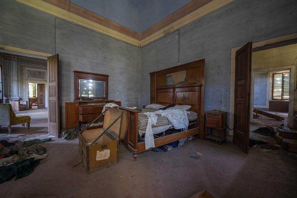 Master bedroom in abandoned Villa Pavone