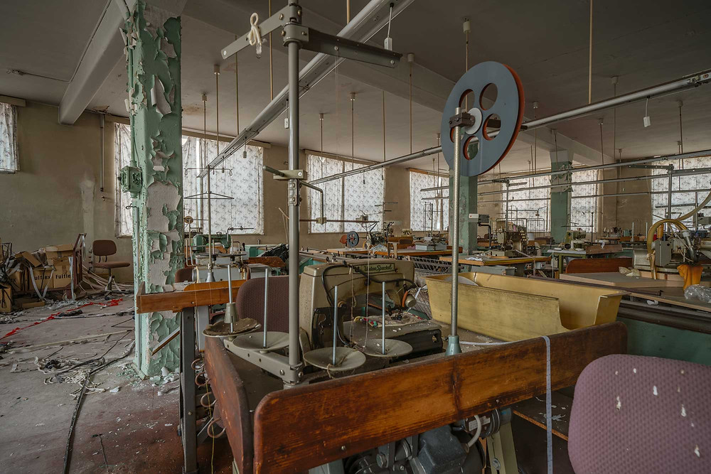 Sewing machine at abandoned clothing factory in Germany