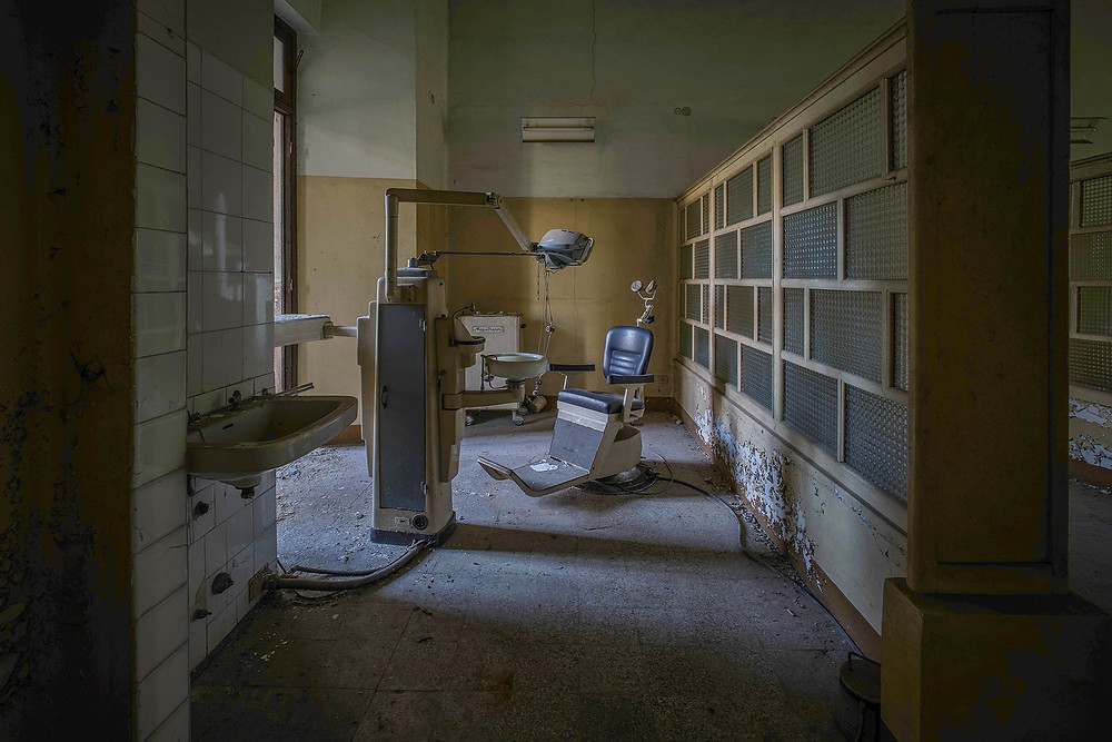 Dentist chair in abandoned mental asylum