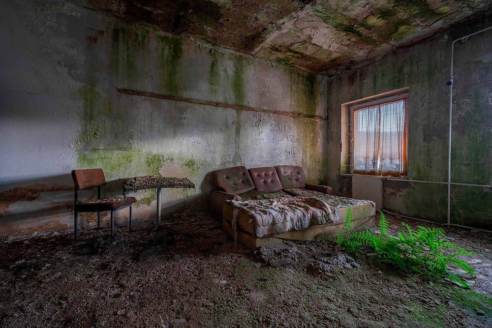 Natural decay in abandoned DDR hotel in Germany