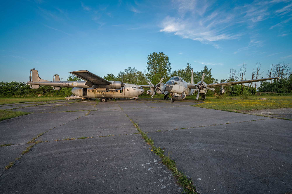 Abandoned military aeroplanes in the sunset